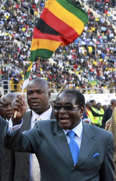 Robert Mugabe with national flag